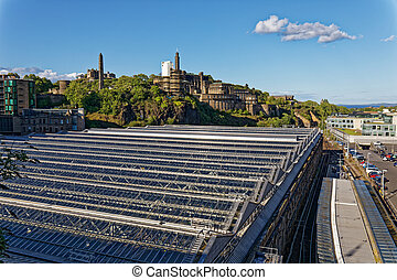 Calton Hill and Edinburgh train station roof - Edinburgh, Scotland, United Kingdom