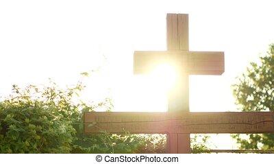 Calvary cross of christ and sun rising sky.