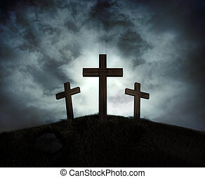 Silhouette of three crosses on a hill with a sunburst behind them