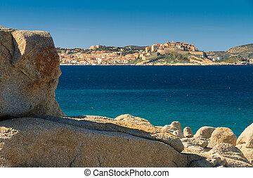 Calvi citadel viewed from across Calvi Bay in Corsica with...
