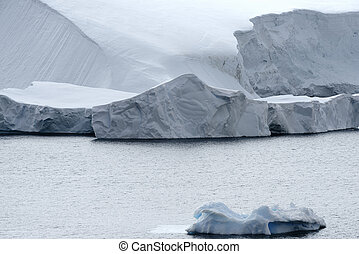 Calving glacier and large icebergs at Paradise Bay, Antarctic Peninsula