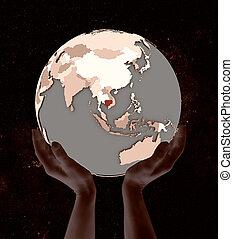 Cambodia on globe in hands