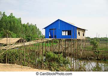 Cambodian house of poor family at Tonle Sap Lake in Cambodia