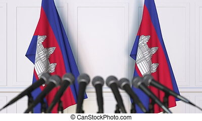 Cambodian official press conference. Flags of Cambodia and...