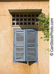 Cambodian style windows in Phnom Penh