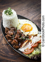 cambodian traditional khmer beef lok lak meal on wooden...