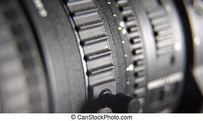 Camcorder camera zoom lens adjustment. Sliding control rings...