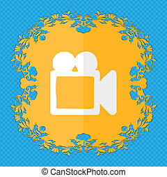 camcorder. Floral flat design on a blue abstract background with place for your text.