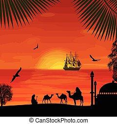 Camel caravan at beautiful sunset on the beach