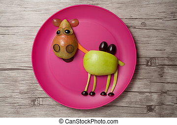 Camel made with fruits on plate and desk