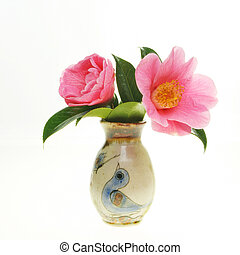 Camellia in vase - Two camellia flowers in a decorated vase