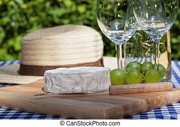 Camembert cheese and grapes