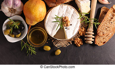 camembert portion with pear, walnut and bread