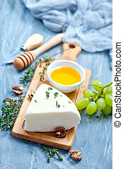 camembert with honey on board, stock photo