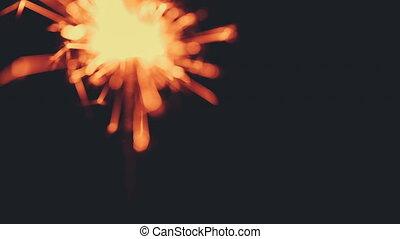 Camera adjusts the focus on the burning bengal light.