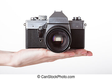 Camera and hand - A retro reflex camera held on one hand