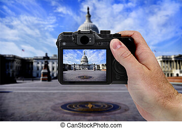 Camera and US Capitol Building Tourist