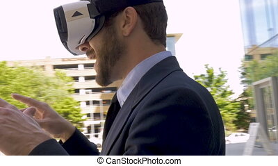 Camera circles a businessman wearing a VR headset virtual reality working