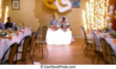 groom and bride sitting at wedding table - camera comes...
