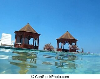 camera diving into water swimming pool