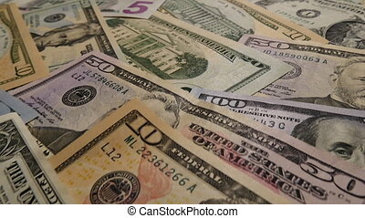 Camera dolly shot of US currency