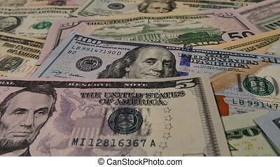 Camera dolly shot of US currency - Camera tracks over...