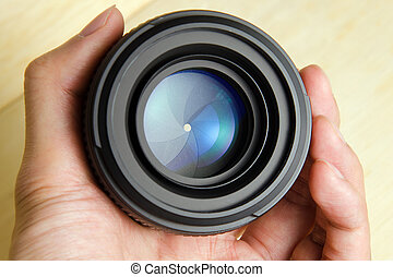 Camera dslr lens with hand holding