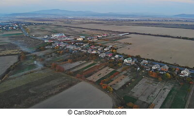 Camera flight over small village fall colors small town -...