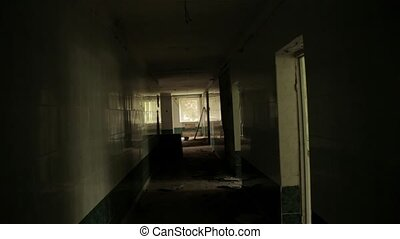 Camera flying in the hallway of the abandoned house. POV, steadycam