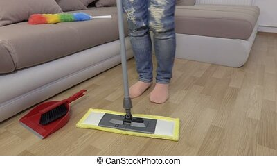 Camera focusing on woman with mop who dancing and cleaning floor