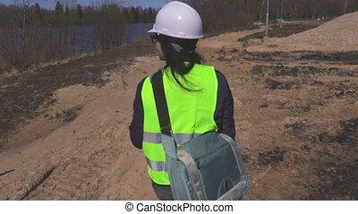 Camera follow woman engineer