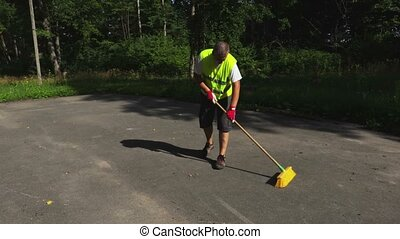 Camera follow worker with yellow brush