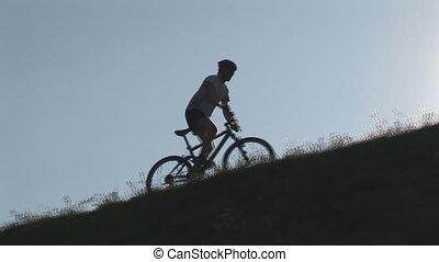 camera following mountainbiker
