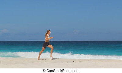 camera following woman running fast - pan shot of woman...