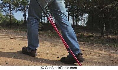 Camera follows hiker legs