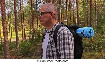 Camera follows Hiker with backpack