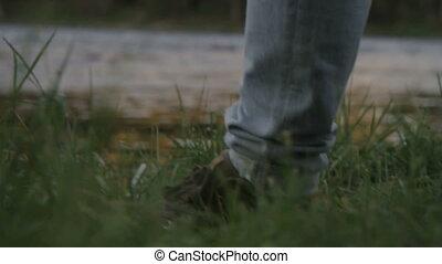 Camera follows the legs of a woman walking