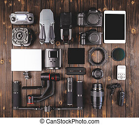 camera gear on wood top view