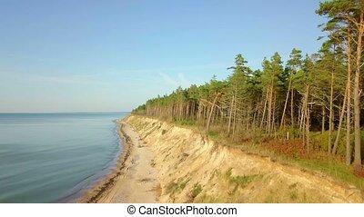 Camera goes up near the sea steep bank