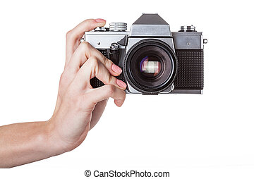 Camera holding - A man holding a reflex camera in his hand