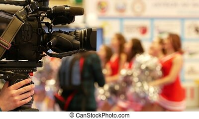 Camera in front of girls cheerleaders at the karate...
