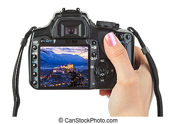 Camera in hand and winter Austria view