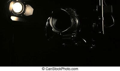 Camera jib crane with remote hot head operation in studio