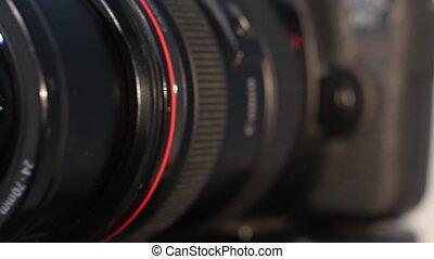 Camera lens with lense reflection - turns - Black camera...
