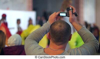 Camera man concert crowd - Man camera shooting in concert