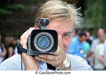 Camera Man Holding Digital Video Recorder