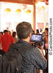 Camera man taking video