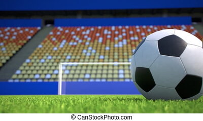 camera move towards a soccer ball lying on grass in an empty stadium