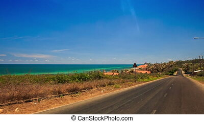 Camera Moves along Asphalt Road by Azure Sea - camera moves...