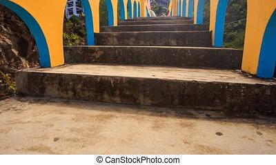 Camera Moves along Blue Yellow Bridge to Pagoda in Vietnam
